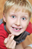Where are you, tooth fairy. Little boy showing his first lost milk-tooth, he is waiting for tooth fairy Stock Photography