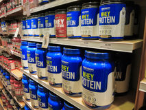 Whey protein jars on store shelf stock photography