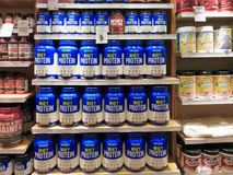 Whey protein jars on store shelf Stock Images
