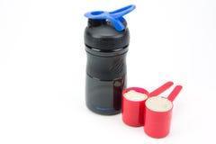 Whey protein powder and plastic shaker Stock Photo