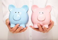 Which Coin Bank Is Heavier? Royalty Free Stock Images