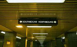Which Direction?. Sign in subway showing northbound and southbound directions. Can be used for decision making concept Royalty Free Stock Image