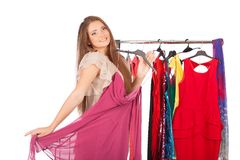 Which dress should I pick, young woman holding wear Royalty Free Stock Photos