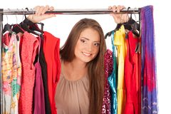 Which dress should I pick, young woman holding wear Royalty Free Stock Image