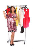 Which dress should I pick, young woman holding wear Stock Image