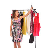 Which dress should I pick, young woman holding wear Stock Images