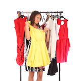 Which dress should I pick, young woman holding wear Stock Photos