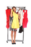 Which dress should I pick, young woman holding wear Stock Photo