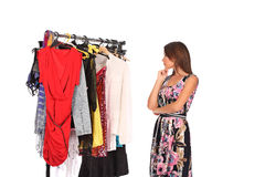 Which dress should I pick, young woman holding wear Royalty Free Stock Photo