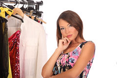 Which dress should I pick, young woman holding wear Royalty Free Stock Images
