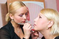 Which girl of a lip paints Stock Image