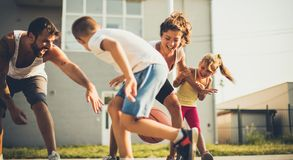 Which team will win?. Family playing basketball. Close up royalty free stock photo