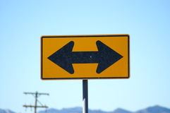 Which way. Sign with two arrows showing different directions royalty free stock image