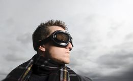 Which way to go. Male model poses as a pilot Stock Image