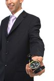 Which way to go?. Businessman offering modern compass on white, shallow dof Stock Photo