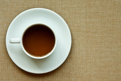 Whie Coffee Cup On Cloth Texture Stock Image