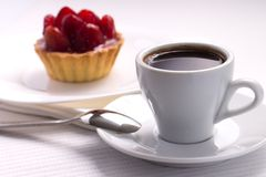Whie Cup of Black Coffee with Strawberry Dessert Royalty Free Stock Photo