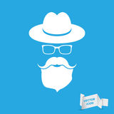 Whie hat with mustache, beard and glasses isolated on a blue bac. Kground Royalty Free Stock Photography