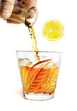 Whiff of alcohol pours with splashes into the glass with lobu Stock Photo