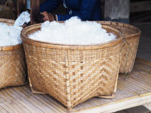 Whiie silk cotton in bamboo basket Stock Image