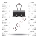 Whimsical binder clip 2016 calendar. With the year hanging from the clip Royalty Free Stock Photography