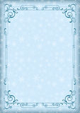 Whimsical blue rectangular frame and winter background with snowflakes. Stock Photography