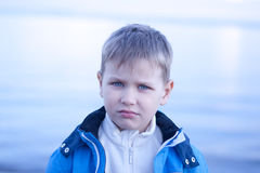 Whimsical blue-eyed boy by the seashore Royalty Free Stock Photo