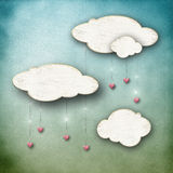 clouds with heart drops blue sky Royalty Free Stock Photo