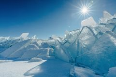 View on and through ice on frozen fields of Lake Baikal royalty free stock images