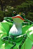 Whimsical frog on lily pad Royalty Free Stock Image
