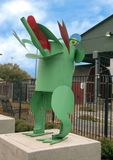 Whimsical frog sculpture, Dallas Farmers Market, one of six metal sculptures, Dallas, Texas. Pictured is a whimsical frog, one of six metal sculptures in front stock image