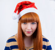 Whimsical girl in a New Year's cap Royalty Free Stock Photography