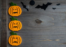 Whimsical Halloween background image of handmade felt jack-o-lantern Stock Image