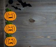 Whimsical Halloween background image of handmade felt jack-o-lantern Stock Photos