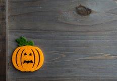 Whimsical Halloween background image of handmade felt jack-o-lantern Royalty Free Stock Photo