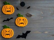 Whimsical Halloween background image of handmade felt jack-o-lantern Royalty Free Stock Photography
