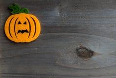 Whimsical Halloween background image of handmade felt jack-o-lantern Stock Images