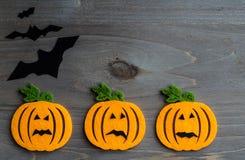 Whimsical Halloween background image of handmade felt jack-o-lantern Stock Image