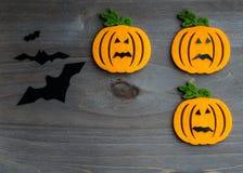 Whimsical Halloween background image of handmade felt jack-o-lantern Royalty Free Stock Photos