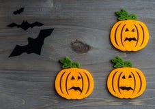 Whimsical Halloween background image of handmade felt jack-o-lantern Royalty Free Stock Images