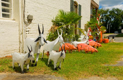 Whimsical hand-crafted garden ornaments. Endearing animals made of tin for sale at a landscaping store Royalty Free Stock Image