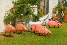 Whimsical hand-crafted garden ornaments. Endearing animals made of tin for sale at a landscaping store Royalty Free Stock Images