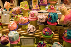 Whimsical hats being sold at an indoor market in vancouver Royalty Free Stock Photo