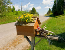 A whimsical mailbox in the countryside Stock Image