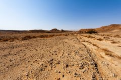 Whimsical Patterns of the Desert. Rocky hills of the Negev Desert in Israel. Breathtaking landscape of the rock formations in the Southern Israel. Dusty stock image