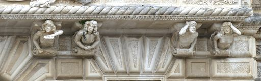 Whimsical sculpted figures on struts of a  balcony. NARDO, ITALY - APR 7, 2019 - Whimsical sculpted figures on struts of a  balcony in Nardo, Puglia, Italy stock images
