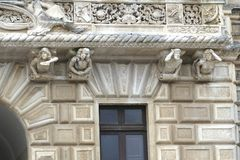 Whimsical sculpted figures on struts of a  balcony. NARDO, ITALY - APR 7, 2019 - Whimsical sculpted figures on struts of a  balcony in Nardo, Puglia, Italy royalty free stock photos
