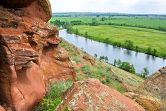 Whimsical stones. Orenburg region. And at the bottom of the cliff is a smooth plain stock images