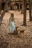 A Whimsical Stroll. A girl having fun in the woods during the Sherwood Forest Faire. The fair goes weekends until March 31 Royalty Free Stock Image