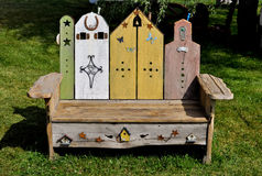 Whimsical wooden bench Stock Images